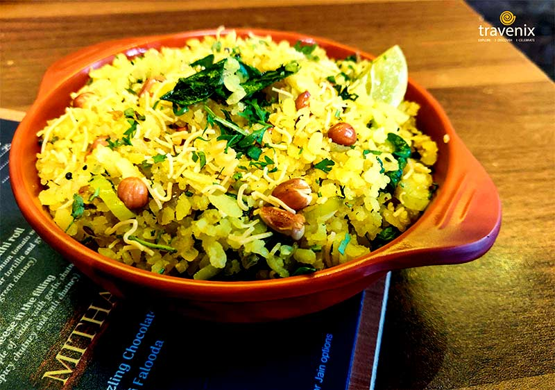 soft Poha loaded with crispy peanuts