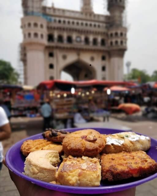 Nimrah Cafe and Bakery with Charminar at the backdrop